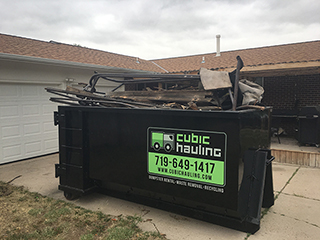 overfilled dumpster colorado springs
