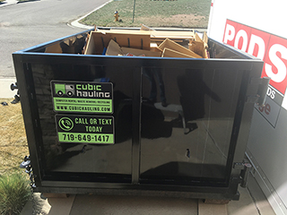 properly filled dumpster colorado springs